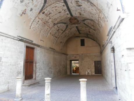 The Painted Vault passage with wall and ceiling frescoes